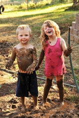 Little Kids Playing in Mud